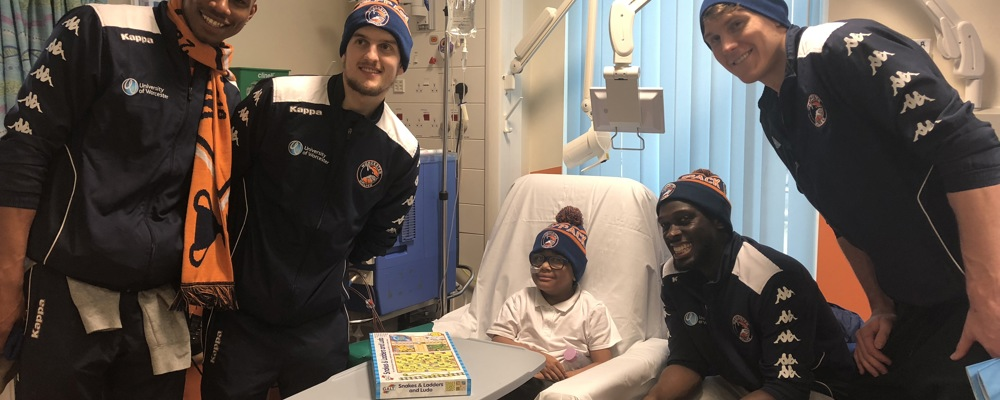 Basketball stars help lift spirits at hospital visit